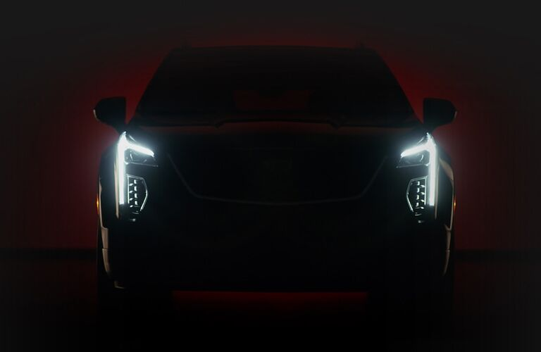 2019 Cadillac CT6 sedan exterior front shot with LED headlights lit up in the dark