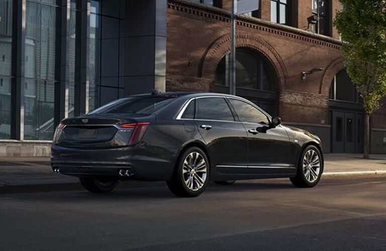 2019 Cadillac CT6 sedan exterior side shot with dark black metallic paint color parked on a city street