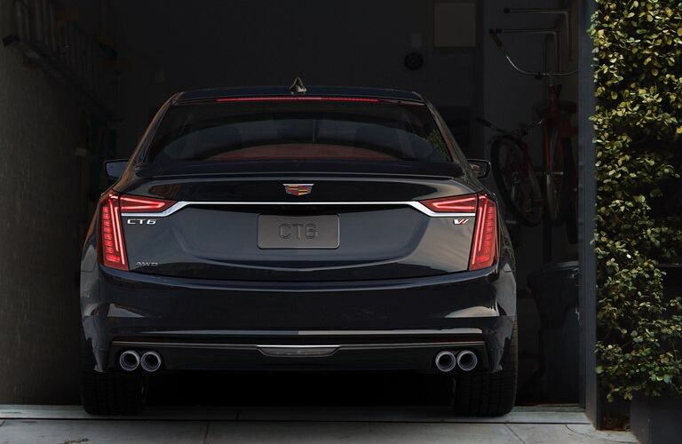 2019 Cadillac CT6 sedan exterior rear shot of back bumper, trunk, and taillights as it pulls into a garage