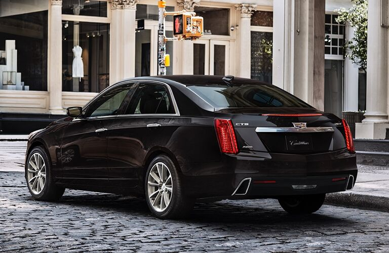 2019 Cadillac CTS exterior rear shot with black paint color parked on a stone tiled road