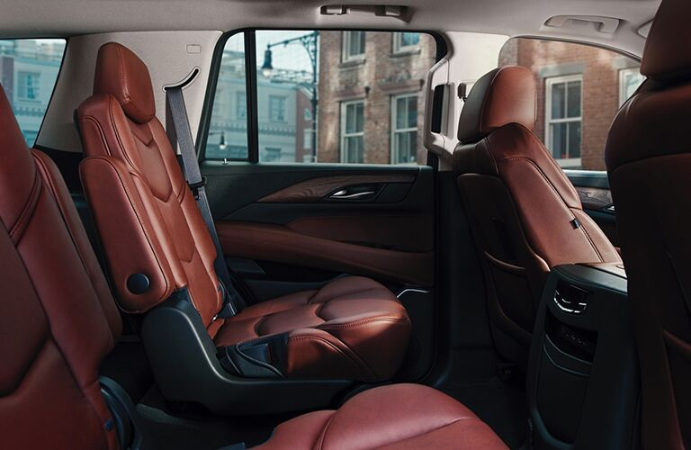 2019 Cadillac Escalade interior side shot of seating rows with red leather upholstery