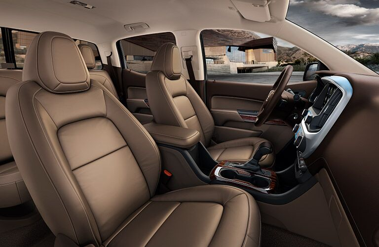 2019 GMC Canyon interior shot of front and rear seating with brown leather upholstery
