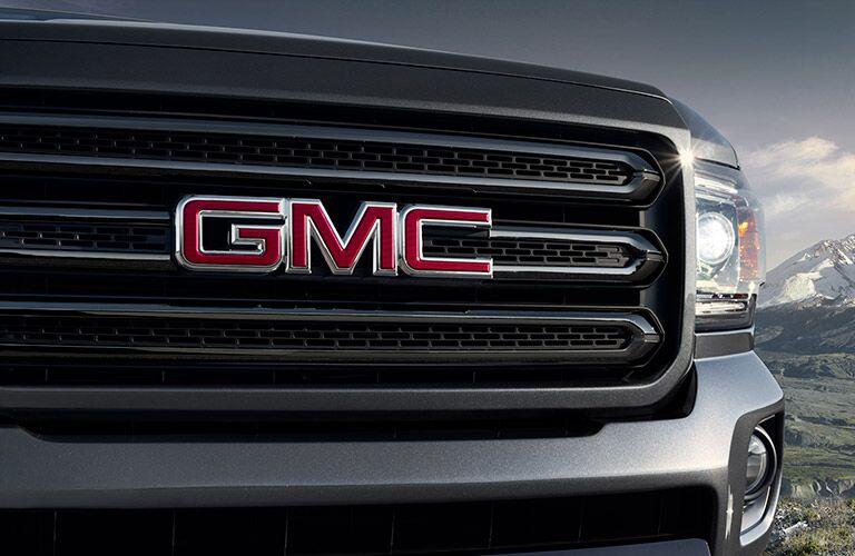 2019 GMC Canyon exterior closeup of signature grille and GMC badge