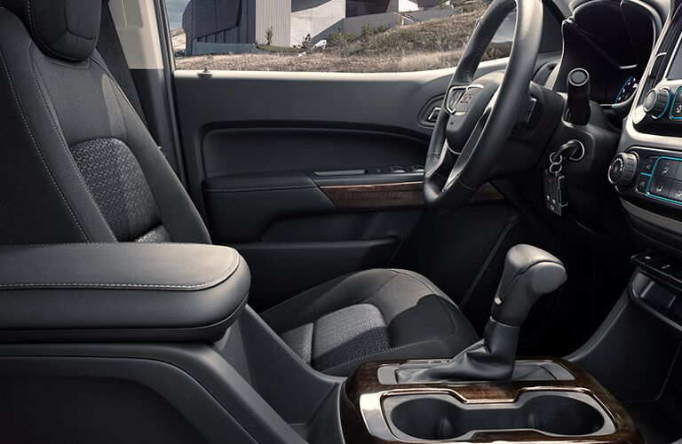 2019 GMC Canyon interior side shot of driver's seat, steering wheel, and transmission