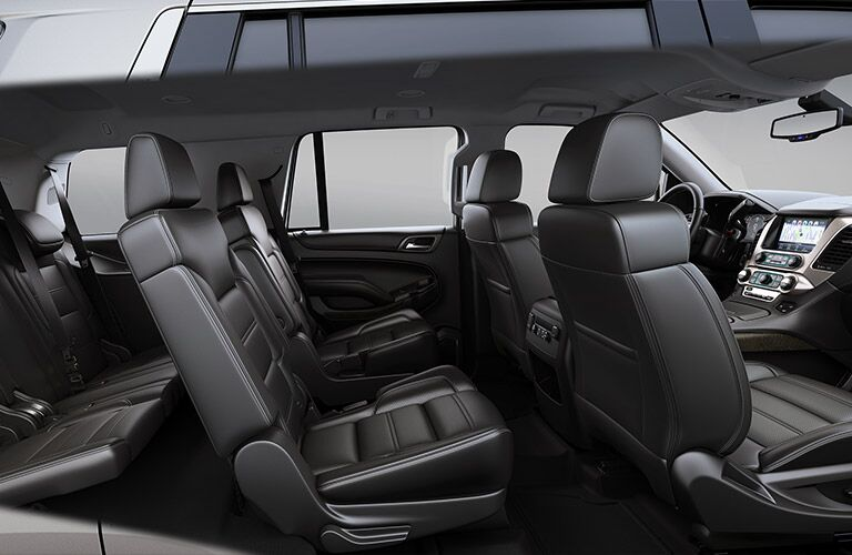 2019 GMC Yukon Denali interior side shot of three-row seating and black leather upholstery