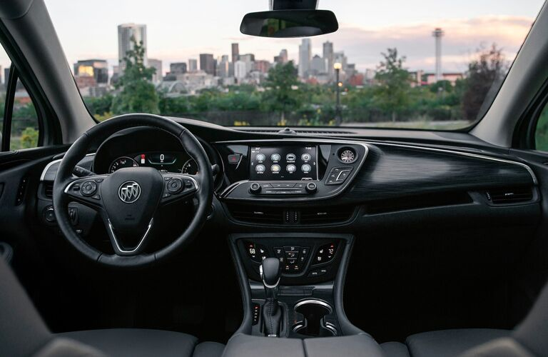 2020 Buick Envision interior shot of front seating, steering wheel, transmission, and dashboard
