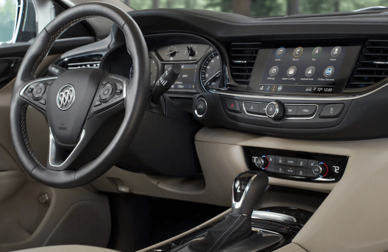 2020 Buick Regal TourX interior shot of steering wheel, dashboard, and transmission