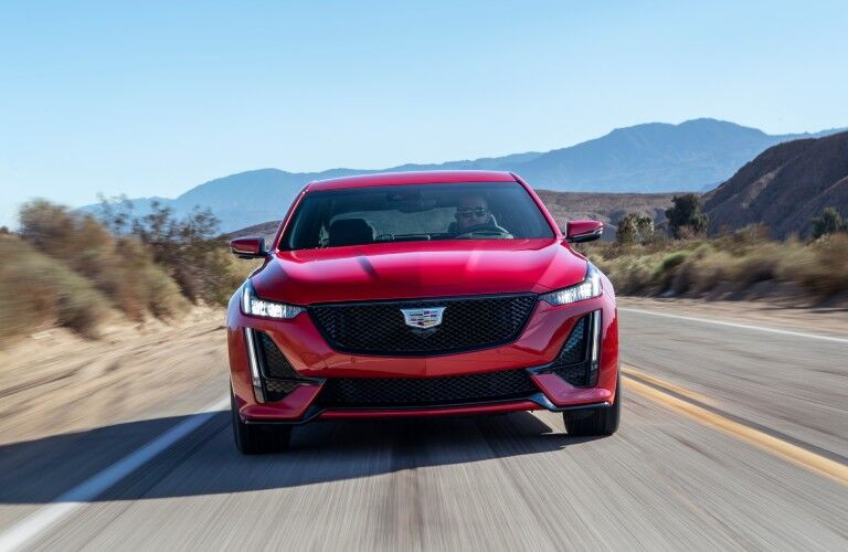 2020 Cadillac CT5-V exterior front shot with red paint color driving down a desert highway