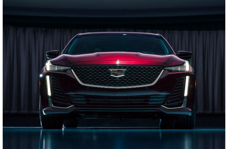 2020 Cadillac CT5 Premium Luxury exterior front shot with dark red maroon paint color showcasing grille and headlight design
