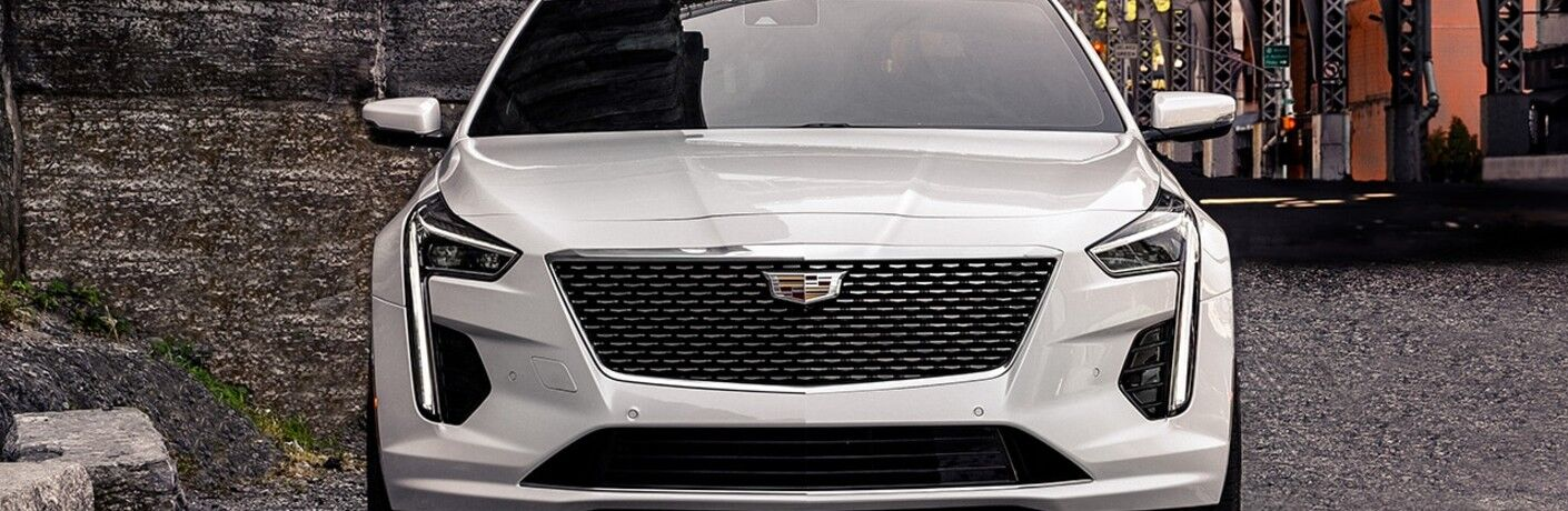 2020 Cadillac CT6 exterior front shot of signature headlights and grille with white paint color