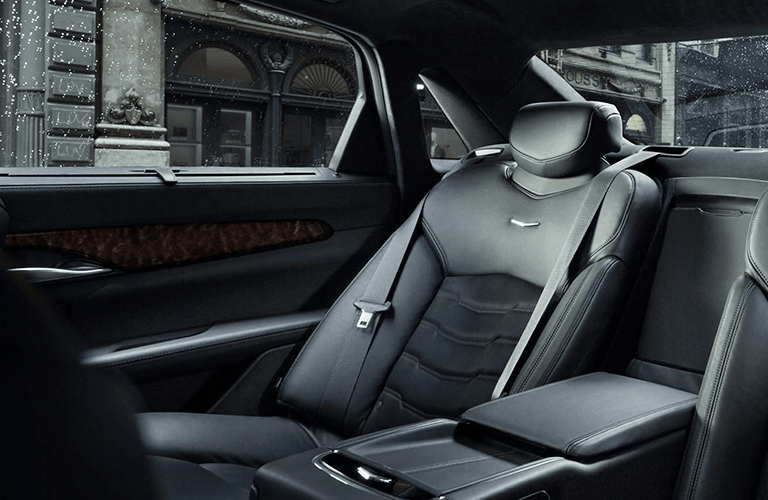 2020 Cadillac CT6 interior shot of back row seating, windows, and carbon fiber trim