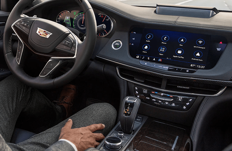 2020 Cadillac CT6 interior shot of steering wheel, commander control knob, transmission, and dashboard layout