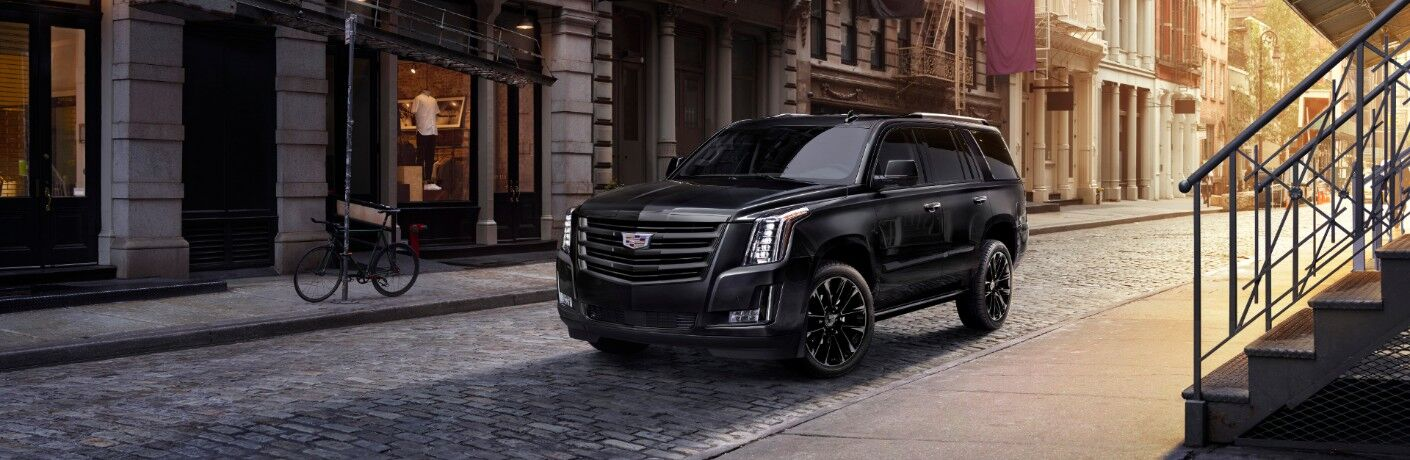 2020 Cadillac Escalade Sport Edition exterior shot with black paint color parked on an empty stone street