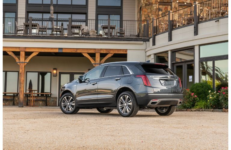 2020 Cadillac XT5 Premium Luxury exterior side rear shot with gray blue paint color parked outside a luxury restaurant resort