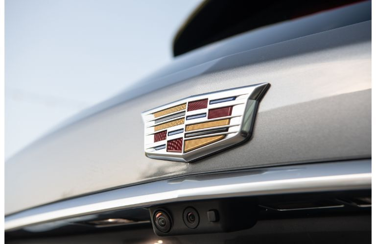 2020 Cadillac XT5 exterior rear closeup of brand badge logo and camera on the rear trunk and bumper