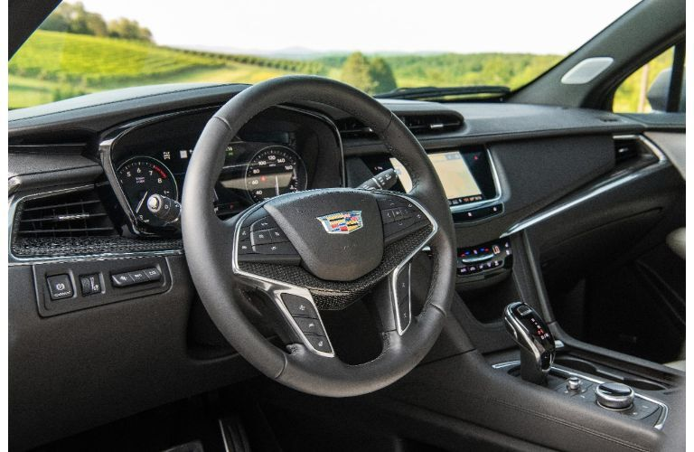 2020 Cadillac XT5 interior shot of steering wheel, dashboard, and infotainment setup