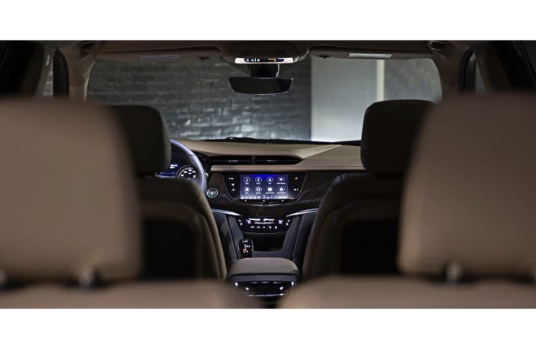 2020 Cadillac XT6 SUV interior shot from thrid row showing scope of cabin seating