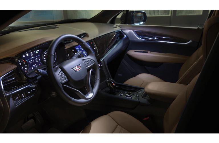 2020 Cadillac XT6 SUV interior shot of front seating, steering wheel, and dashboard design and accents