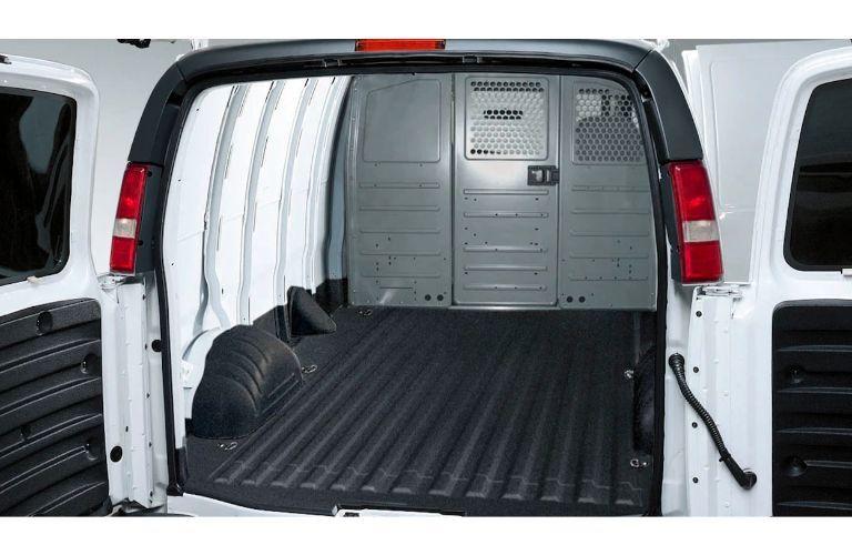 2020 GMC Savana Cargo van rear shot with back doors open showing off cargo space