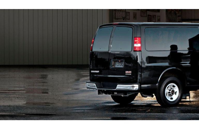 2020 GMC Savana Passenger van exterior shot of rear doors with black paint color