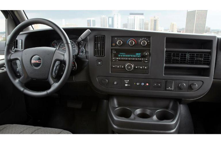 2020 GMC Savana Passenger van interior shot of steering wheel and dashboard