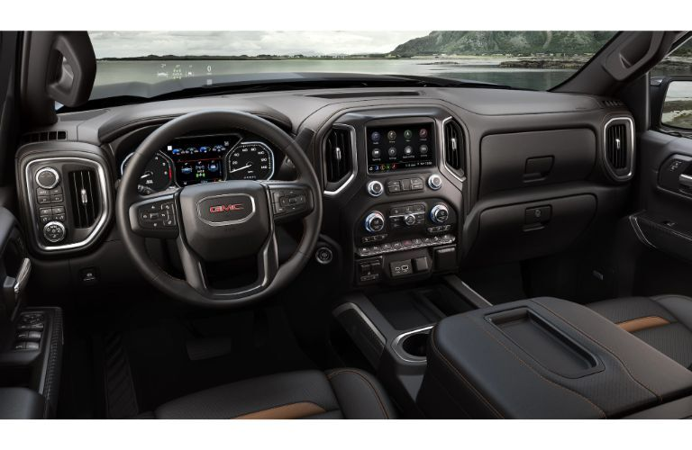 2020 GMC Sierra 1500 AT4 interior shot of front seating, steering wheel, and dashboard setup
