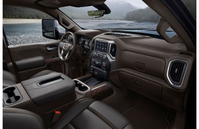 2020 GMC Sierra 3500HD interior shot of front seating upholstery, steering wheel, dashboard design, and trimming