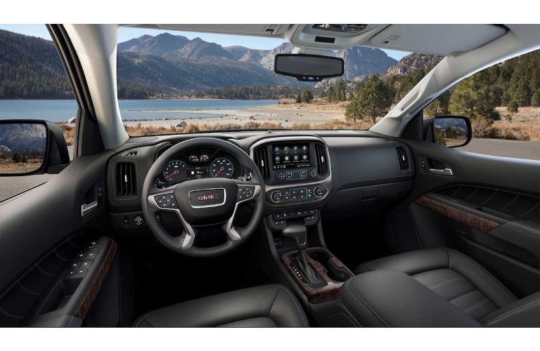 2021 GMC Canyon interior shot of front seating, steering wheel, and dashboard