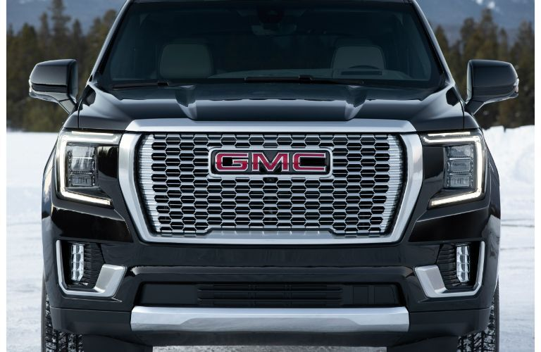 2021 GMC Yukon Denali exterior front shot of grille, headlights, and bumper