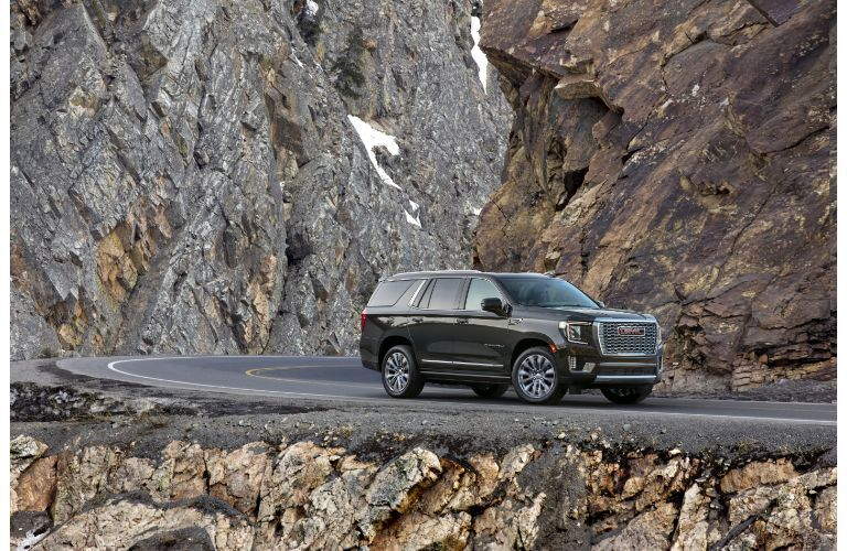 2021 GMC Yukon Denali exterior side shot parked on a mountain side highway