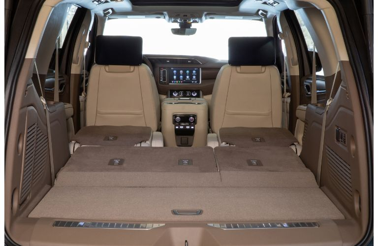 2021 GMC Yukon Denali interior shot of folded down seats and maximum cargo capacity