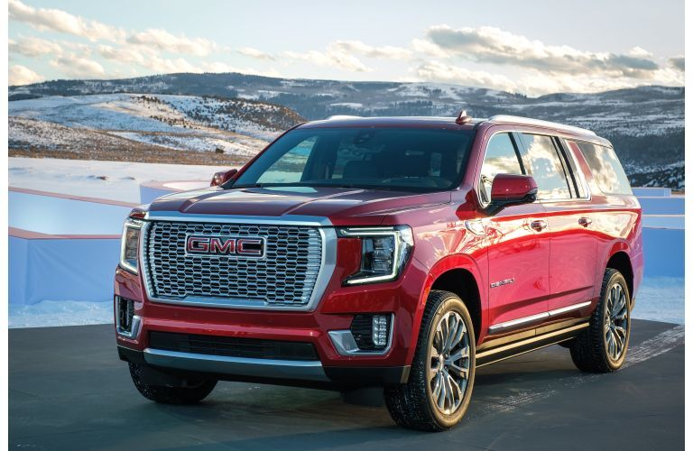 2021 GMC Yukon exterior shot with red paint color with snowy plains in the background