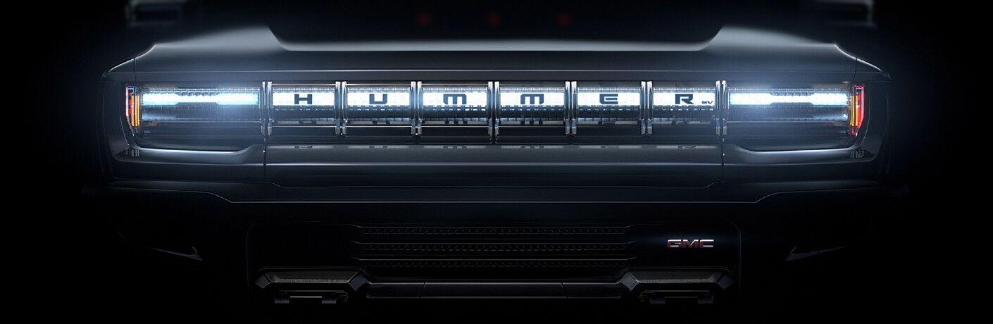 GMC Hummer EV truck Quiet Revolution grille sneak shot teaser