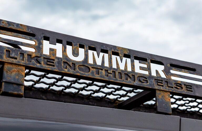 Hummer Like Nothing Else logo and catchphrase set against the sky