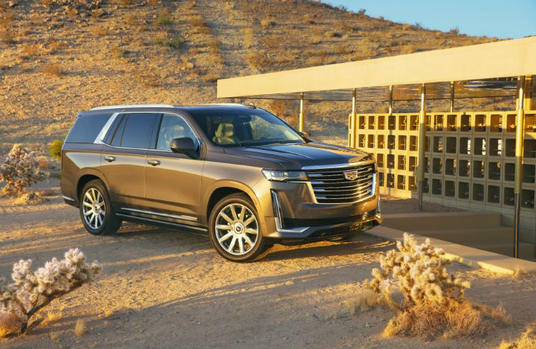 A photo of the 2021 Cadillac Escalade ESV parked in the desert.