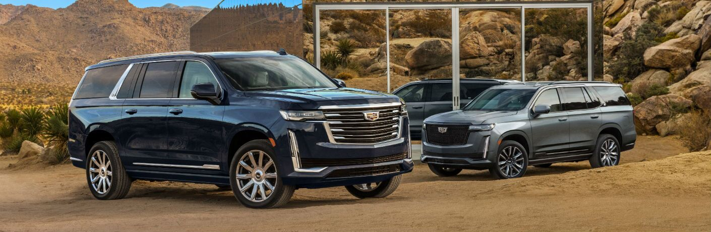 A photo of the 2021 Cadillac Escalade ESV parked by a desert home.