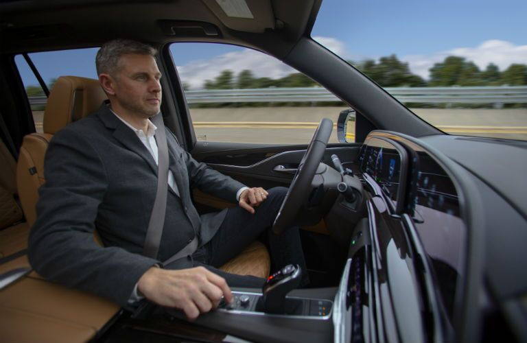 A photo of a person using the Super Cruise feature in the 2021 Cadillac Escalade ESV.