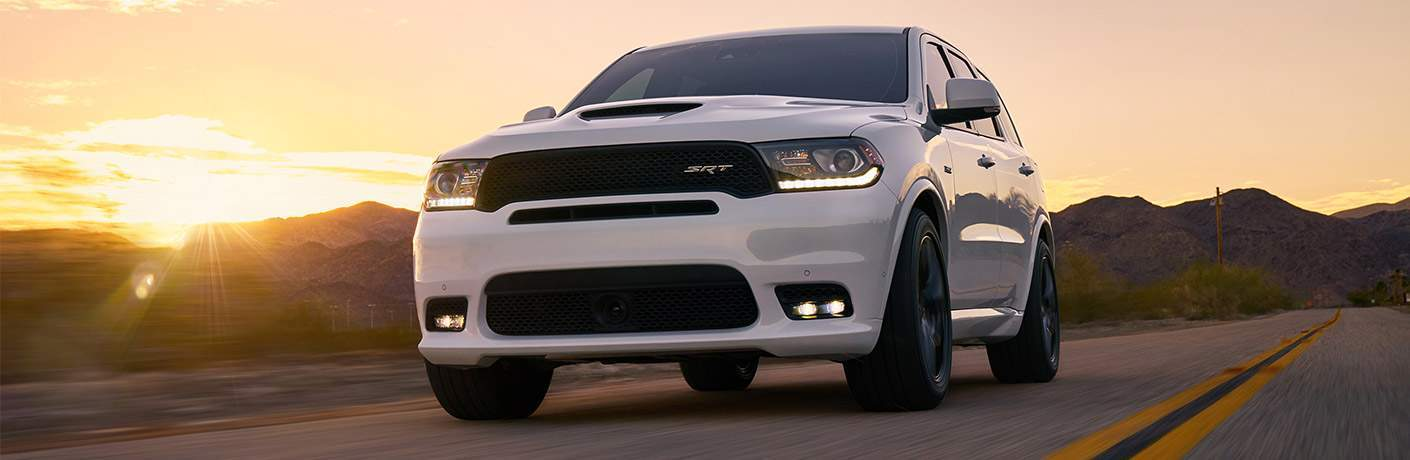 White 2018 Dodge Durango driving at sunset
