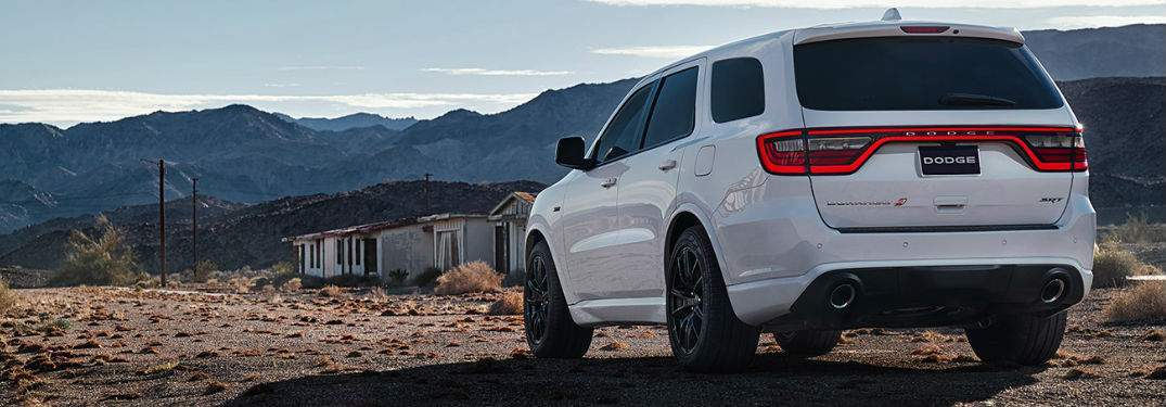 Rear view of white 2018 Dodge Durango on dirt path