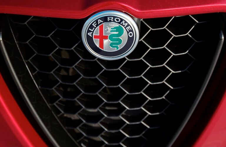 front grille and badge of red 2019 alfa romeo stelvio