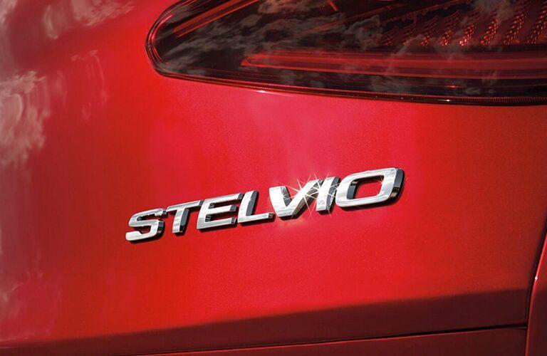 stelvio nameplate on rear of red 2019 alfa romeo stelvio