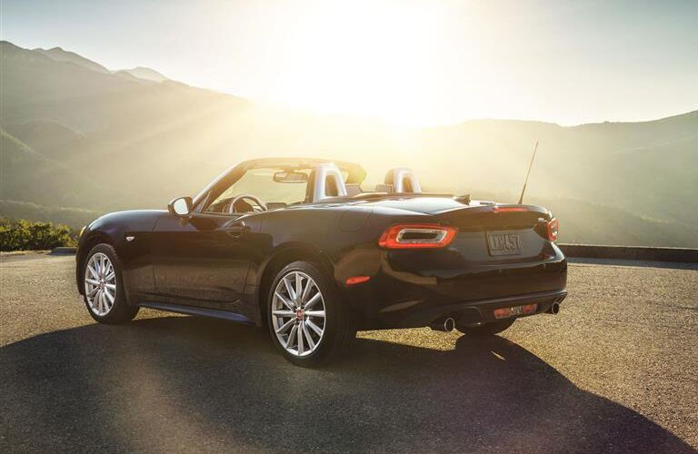 rear and side view of black 2019 fiat 124 spider