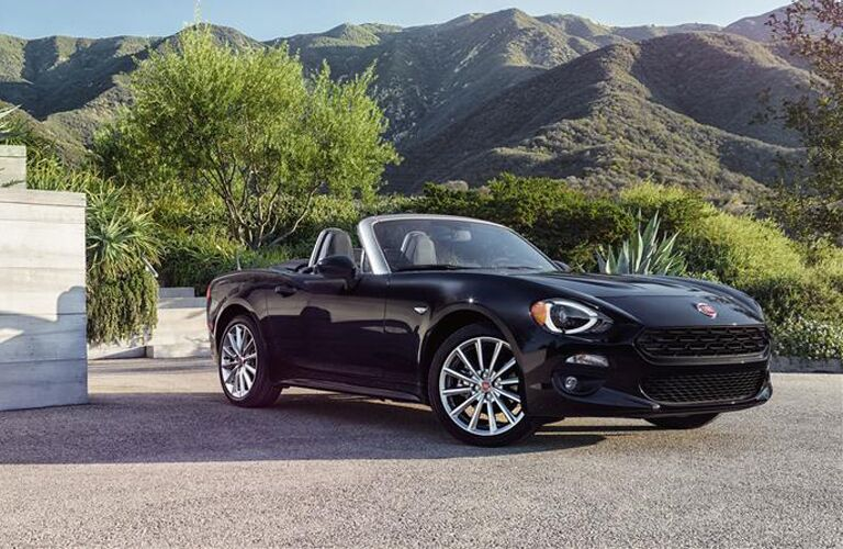 front and side view of black 2019 fiat 124 spider