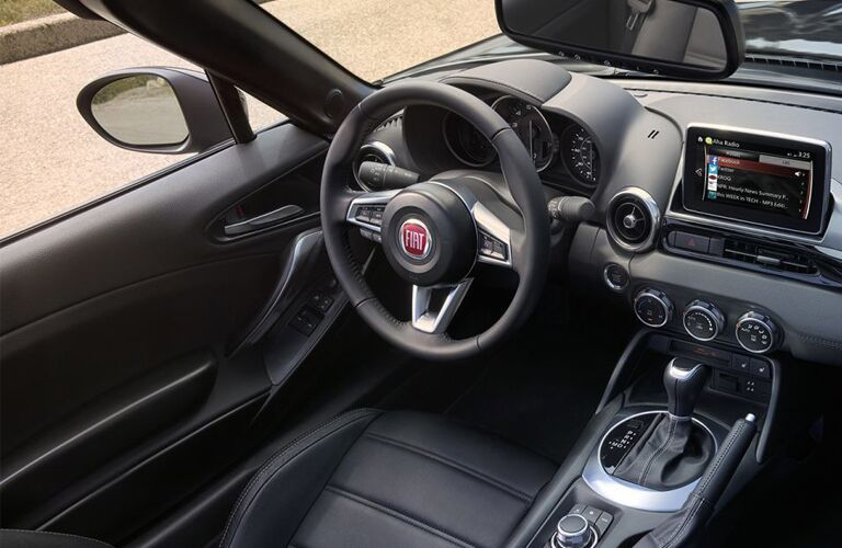 front interior of 2019 fiat 124 spider including steering wheel and infotainment system