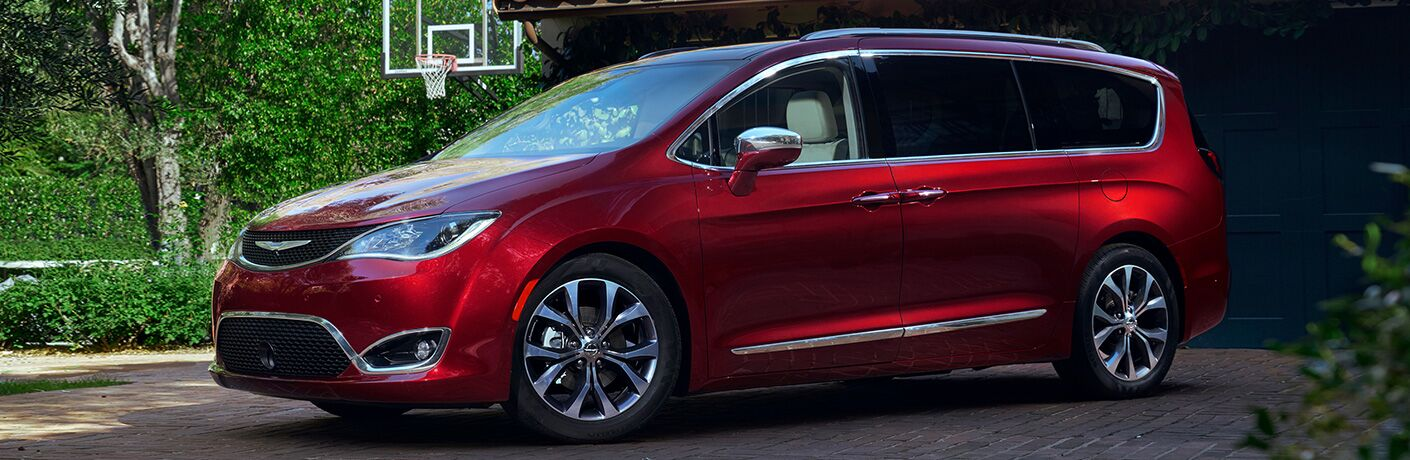 red 2019 chrysler pacifica parked in driveway