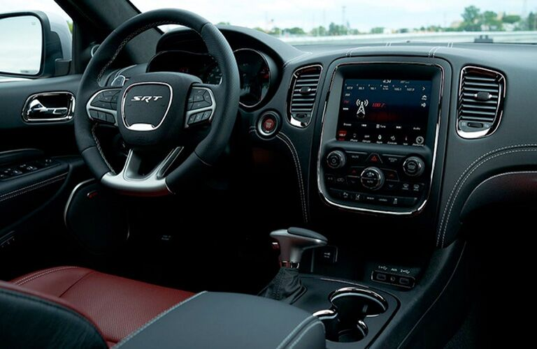 2019 Dodge Durango SRT interior shot of steering wheel, transmission, and dashboard layout