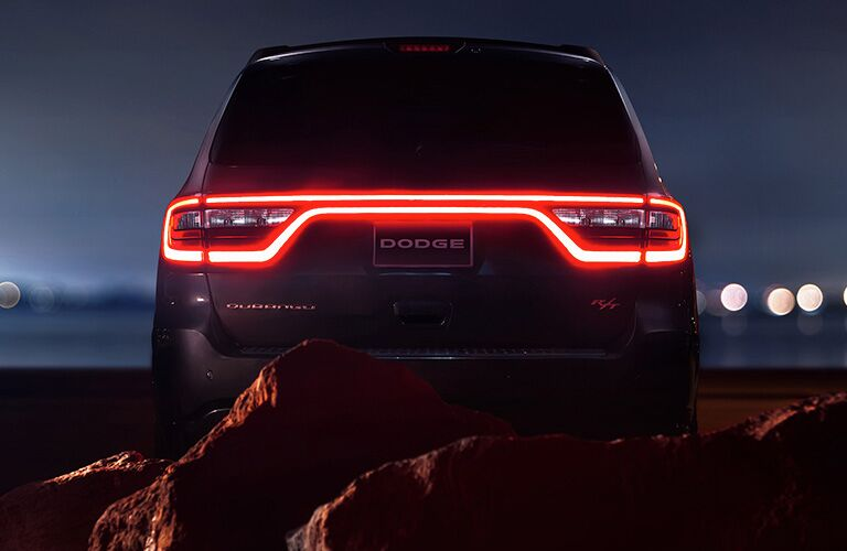 2019 Dodge Durango exterior rear shot with signature LED bar and taillights lit up