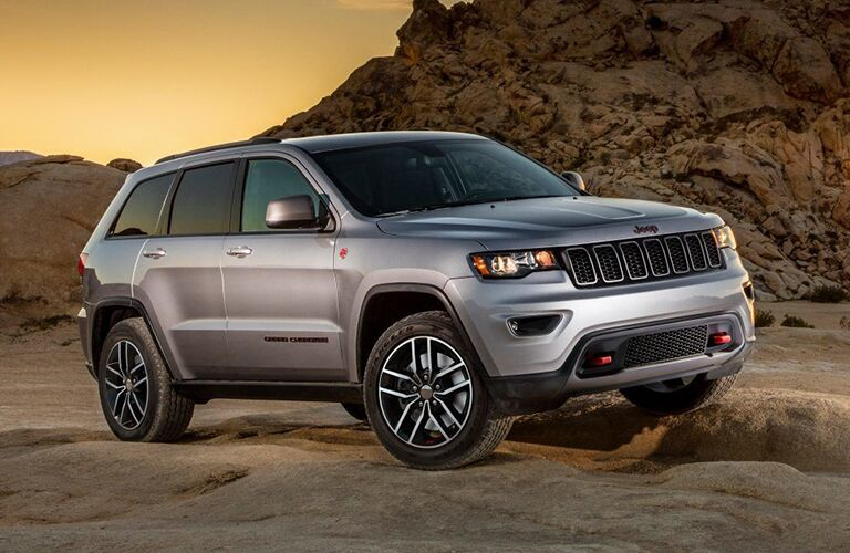 Silver 2019 Jeep Grand Cherokee driving on rocky terrain