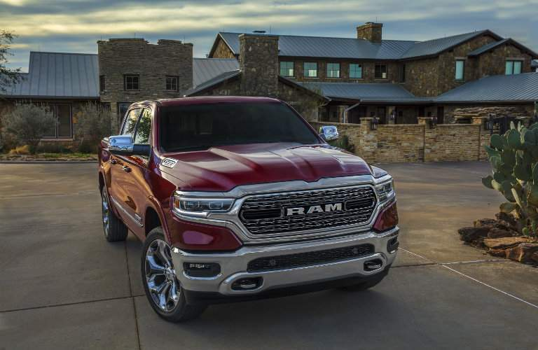 red 2019 Ram 1500 parked by a house