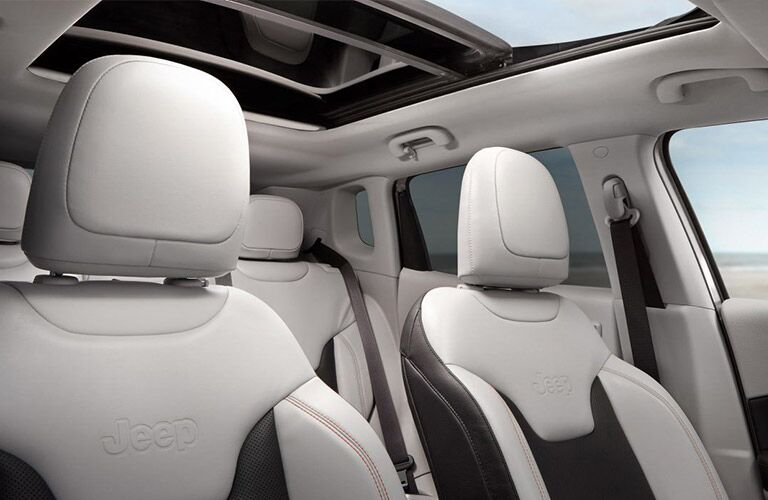 2019 Jeep Compass interior shot of 2-row seating upholstery and sunroof integration
